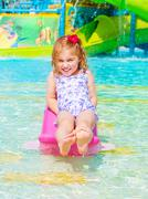 happy girl on water attractions - stock photo