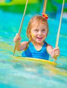 Stock Photo of cheerful girl in aqua-park