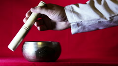 The sound of Tibetan singing bowl Stock Footage