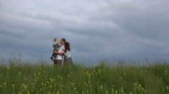 Parent and child stand on spring hill, mother and child play hide and seek 4K Stock Footage