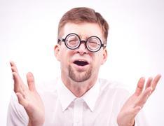 Afraid man in glasses Stock Photos