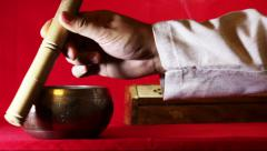Tibetan singing bowl on the red background. With sound Stock Footage