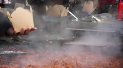 Hot food being sold at a food market, London Stock Footage