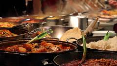 Hot food at a market, London, England Stock Footage