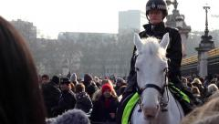 Police woman on white horse Stock Footage