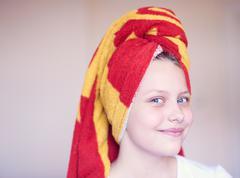 Beautiful happy teen girl with towel on her head Stock Photos
