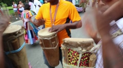 Group of latinos playing music with drums in parade Stock Footage