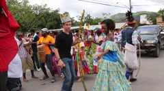 White people dancing with latinos during parade Stock Footage