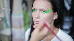 Visagiste makes makeup for  model, professional makeup artist , makeup, body art - stock footage