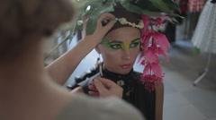 Professional makeup artist tints the model's eye,makeup, professional makeup, - stock footage
