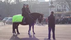 Police officers riding horses Stock Footage