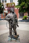 Monument of Happy Chimney Sweeper with cat Stock Photos