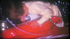 1639 - little girl in minature firetruck on Christmas - vintage film home movie Stock Footage