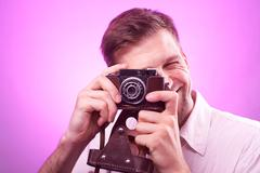 Photographer takes pictures Kuvituskuvat