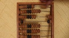 Man uses vintage old abacus Stock Footage