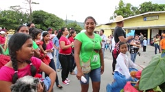 Latina woman dancing and smiling in parade Stock Footage