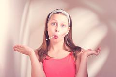 funny teen girl eating lollypop - stock photo