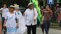 Latino old man carrying the flag and dancing in parade Stock Footage