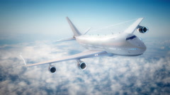 Commercial airline flying above the clouds Stock Footage