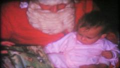 1638 - Santa reads bedtime story to child - vintage film home movie Stock Footage