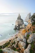 Beautiful beach with rocks in Portugal, Sintra, Cabo da Roca, Praia da Ursa Stock Photos