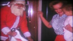 Santa brings gifts for children on Christmas 1637 vintage film home movie Stock Footage