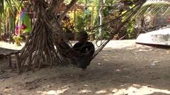 Man in Hammock Swinging Stock Footage