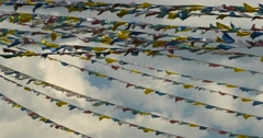 4k prayer flag in wind,clouds background. Stock Footage