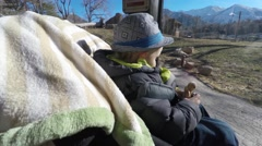 Mother and a toddler in stroller looking at lions in zoo 4k Stock Footage