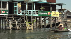 Nyaung Shwe, Cruising waterway with houses on stilts Stock Footage