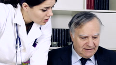Female doctor talking with colleague about patient medical case in studio clo Stock Footage