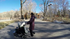 Mother and toddler in stroller at hogle zoo Stock Footage