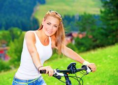 Riding bicycle in alpine mountains Stock Photos
