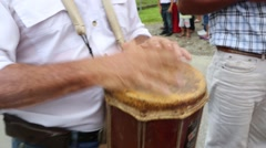 Latino man playing a drum during a parade Stock Footage