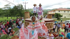 Latino girls dancing on wagon/cart during parade in daytime Stock Footage
