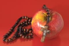 Bible eva's sin red apple Stock Photos