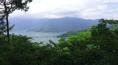 View Of Lake Kawaguchi And Foggy Forest Mountains 4K Stock Footage