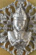 Stock Photo of silver buddha pendant jewel