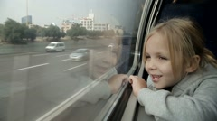 Girl looking out the window on the train Stock Footage