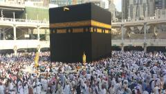Muslim pilgrims circumambulate the Kaaba at Masjidil Haram  in Makkah Stock Footage
