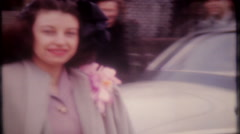 1648 - well dressed women get in & out automobile - vintage film home movie Stock Footage