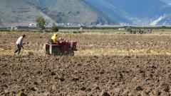 4k tibetan people use farm tractor Arable land in shangrila yunnan,china. Stock Footage