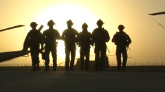 Soldiers in war walking towards the camera at sunset Stock Footage