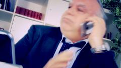 Funny business man trying to relax receiving bad phone call closeup Stock Footage