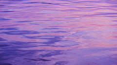 The tranquil water of the peaceful late with beautiful reflection of rosy sky. - stock footage