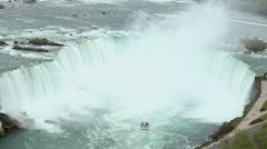Niagara Falls Sightseeing Cruise touring Horseshoe Falls Stock Footage