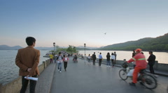 Afternoon scene of the West Lake Bridge in Hangzhou with stream of people. Stock Footage
