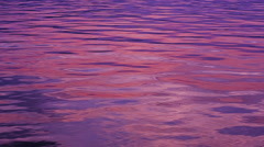 The tranquil water with beautiful reflection of rosy sky. Stock Footage