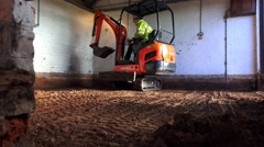 Building construction - mini digger working in confined space Stock Footage