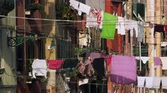Pulling laundry Clothesline Venice Italy 4K Stock Video Footage Stock Footage